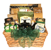 teacup gift basket with assorted tea, cookies and snacks designed by Thoughtful Expressions Gift Baskets Canada