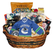Vancouver Canucks themed 'hockey night' gift basket with Canucks gift items and gourmet snacks.